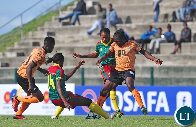 Rachel Nachula of Zambia is tackled by Abena Therese Ninon of Cameroon during the 2018 Cosafa Womens Championship game between Zambia and Cameroon at Wolfson Stadium in Port Elizabeth on 15 September 2018 © Ryan Wilkisky/BackpagePix