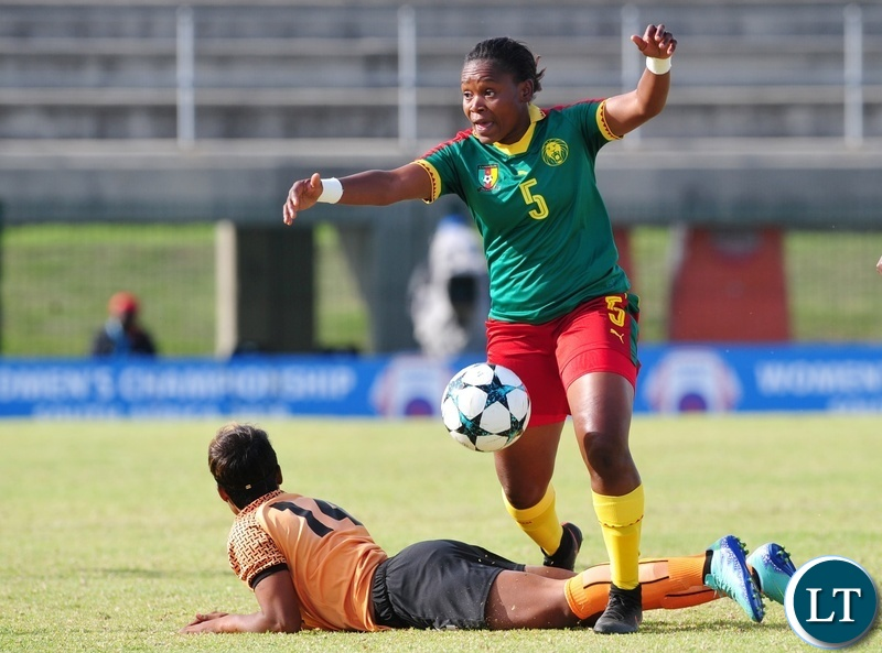 Hellen Chanda of Zambia is fouled by Ejangue Siliki Augustine Sylvia of Cameroon  during the 2018 Cosafa Womens Championship game between Zambia and Cameroon at Wolfson Stadium in Port Elizabeth on 15 September 2018 © Ryan Wilkisky/BackpagePix