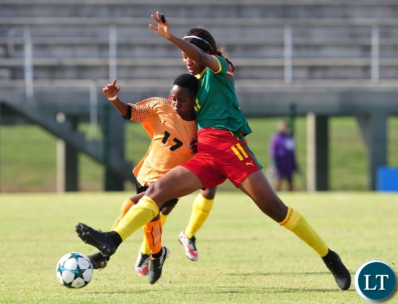 Mary Mwakapila of Zambia is tackled by Raissa Mbappe Etoundi of Cameroon during the 2018 Cosafa Womens Championship game between Zambia and Cameroon at Wolfson Stadium in Port Elizabeth on 15 September 2018 © Ryan Wilkisky/BackpagePix