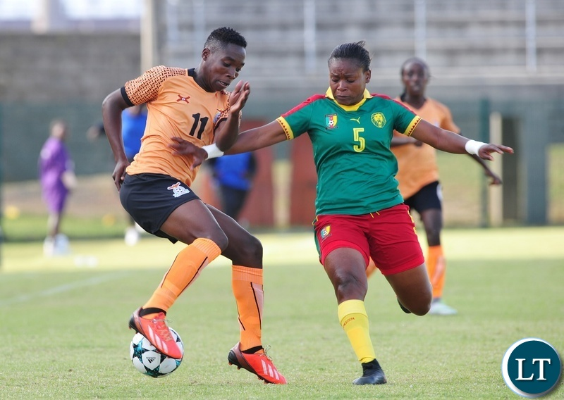 Barbra Banda of Zambia takes on Ejangue Siliki Augustine Sylvia of Cameroon during the 2018 Cosafa Womens Championship game between Zambia and Cameroon at Wolfson Stadium in Port Elizabeth on 15 September 2018 © Ryan Wilkisky/BackpagePix