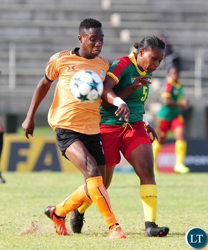 Ejangue Siliki Augustine Sylvia of Cameroon clears the ball ahead of Barbra Banda of Zambia during the 2018 Cosafa Womens Championship game between Zambia and Cameroon at Wolfson Stadium in Port Elizabeth on 15 September 2018 © Ryan Wilkisky/BackpagePix
