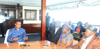 President Edgar Lungu talks to Chief Sekute and chief Simwatachela® in Livingstone