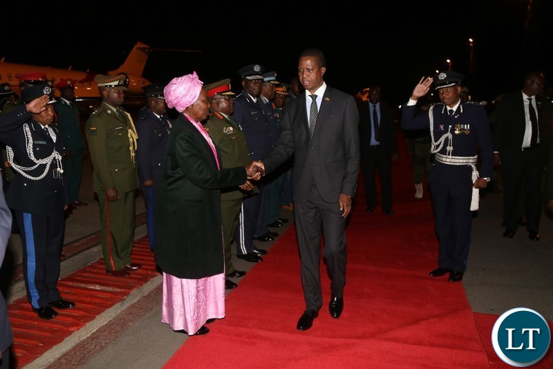 President Edgar Lungu being welcomed by Vice President Inonge Wina on arrival from China at Kenneth Kaunda International Airport