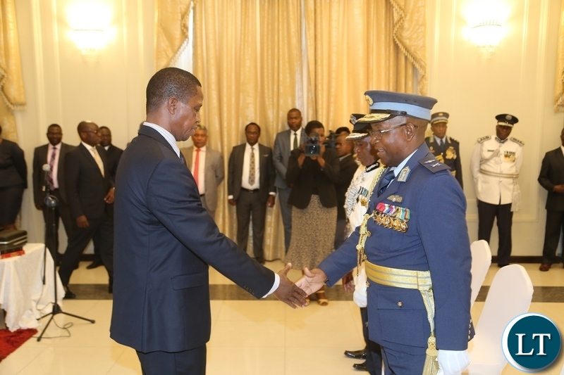 President Edgar Lungu congratulates the newly appointed Deputy Zambia Air Force Commander Major General Kapotwe Chintu shortly after presenting his latter of Oath to the President at State House