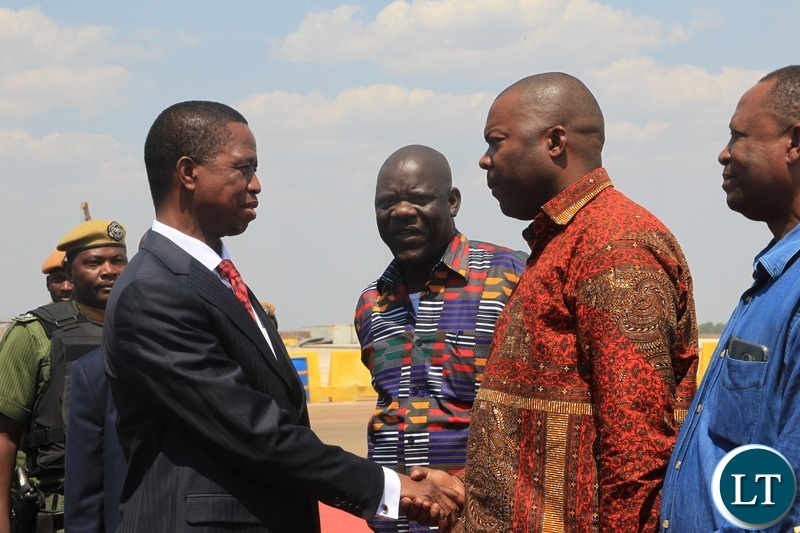 President Edgar Lungu talking to Lusaka Province Minister Bowman Lusambo shortly before departure for Uganda at Kenneth Kaunda International Airport.Picture by SUNDAY BWALYA/ZANIS