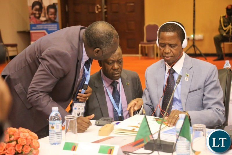 President Lungu consulting with his Defence Minister, Hon. Davies Chama and Special Assistant to the President for Politics, Kaiser Zulu before the official opening of the 9th summit of the Regionaloversight mechanism of peace, security and cooperation frame work for Congo DR