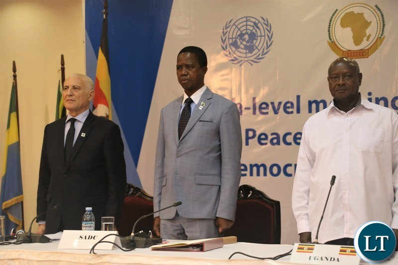 Presidents Lungu  and Museveni and   UN Secretary-General's Special Envoy to the Great Lakes Region, Mr.Said Djinit during the singing of the Uganda National Anthem before   the official opening of the 9th summit of the Regionaloversight mechanism of peace, security and cooperation frame work for Congo DR