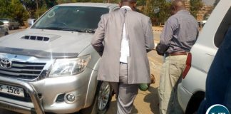 Tayali in a Torn Jacket going to his vadalised vehicle