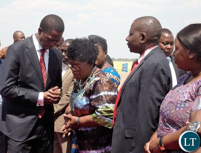 President Edgar Lungu talking to Higher Education Minister Professor Nkandu Luo at Kenneth Kaunda International Airport before departure for Uganda.Picture by SUNDAY BWALYA/ZANIS
