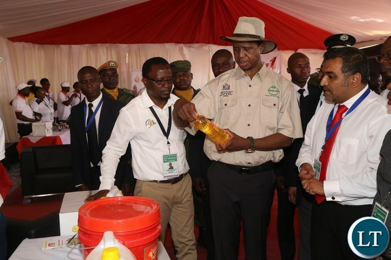 President Edgar Lungu samples mount meru millers products during the tour of stands before the official opening of the Central Province Investment Forum and Expo in Kapiri
