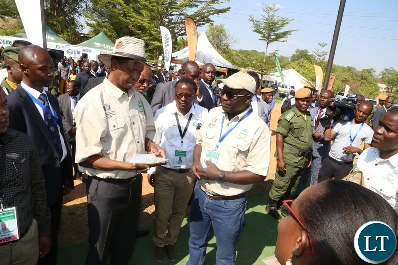 President Edgar Lungu samples Seed Co products during the tour of stands before the official opening of the Central Province Investment Forum and Expo in Kapiri District