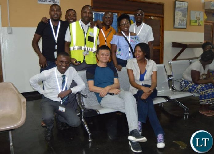 Jack Ma at Mfuwe Airport being welcomed by staff from the Zambia Airports Corporation