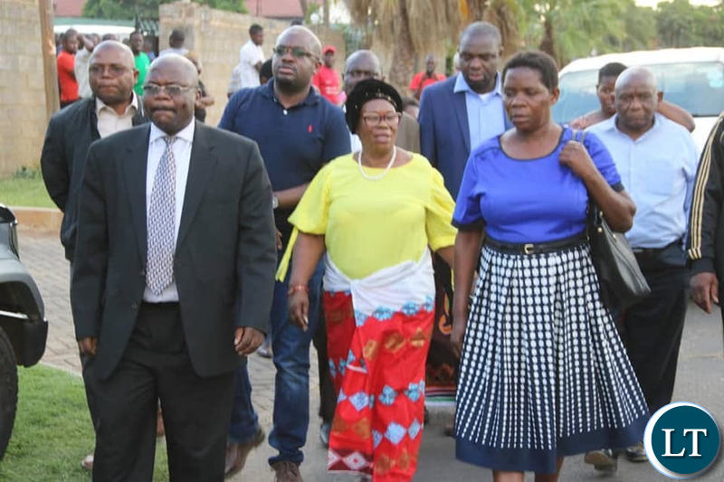 Prof Luo leaving the funeral house after she was chased by UNZA students