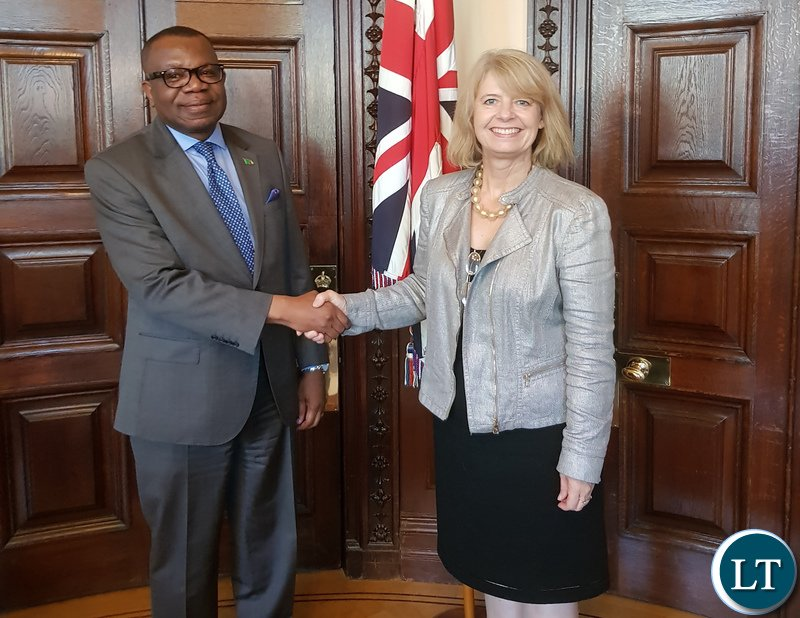 Minister Harriett Baldwin shake hands with High Commissioner Chikonde after a meeting at her office.