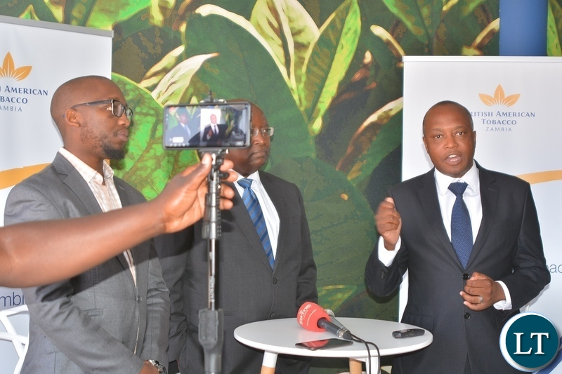 Director of British American Tobacco,Godfrey Machanzi(r) addressing the media during the tour of cigarette manufacturing factory company which has invested over $ 25 million in construction at the Multi Facility Economic Zone in Lusaka.Looking on is Head of operations,Jerry Chivambo(m) and Head of legal,Mdu Lokotfwako(left).
