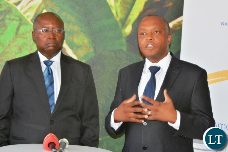 Director of British American Tobacco,Godfrey Machanzi(r) addressing the media during the tour of cigarette manufacturing factory company which has invested over $ 25 million in construction at the Multi Facility Economic Zone in Lusaka.Looking on is Head of operations,Jerry Chivambo