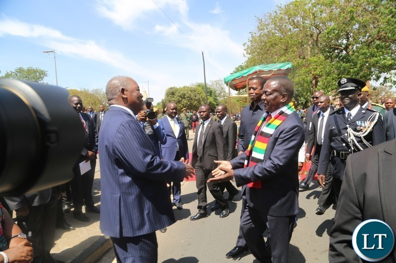 President of Zimbabwe,Emmerson Mnangagwa is welcomed by former fourth President of Zambia,Rupiah Banda at freedom statue for wreath laying ceremony in Lusaka.