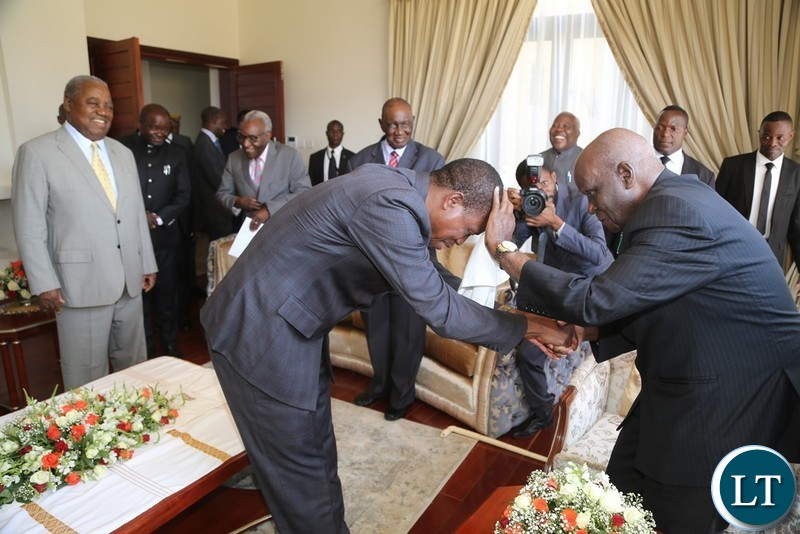 President Edgar Lungu being blessed by First Republican President Dr. Kenneth Kaunda whilst the 4th Republican President Rupiah Banda during the handover ceremony at Bonaventure