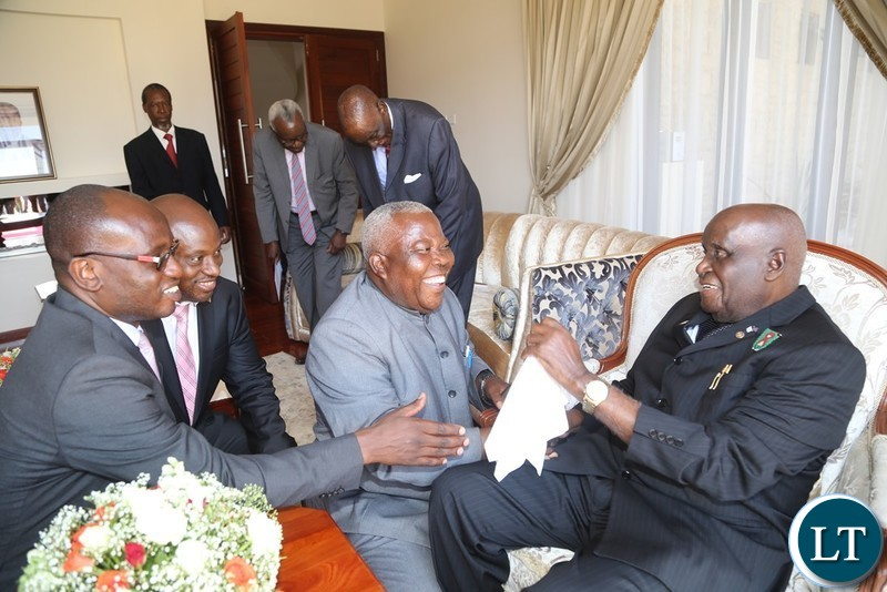 First Republican President Dr. Kenneth Kaunda having a light moment with Presidential Affairs Minister Freedom Sikazwe, Special Assistant to the President for Press and Public Relations Amos Chanda and Special Assistant to the President for Project, monitoring and Implementation Andrew Challah during the handover ceremony of the House to the 4th Republican President Rupiah Banda at Bonaventure