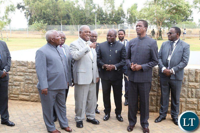 4th Republican President Rupiah Banda confers with President Edgar Lungu who is flanked by Presidential Affairs Minister Freedom Sikazwe and Minister of Infrastructure Ronald Chitotela during the inspecting the House before official handover during the handover ceremony at Bonaventure