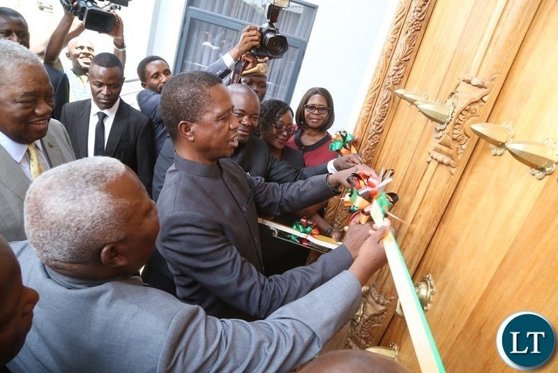 President Edgar Lungu cuts the ribbon to officially handover the retirement House to the 4th Republican President Rupiah Banda during the handover ceremony at Bonaventure