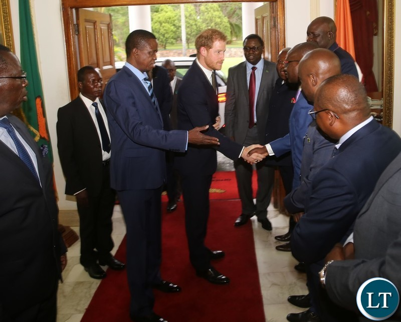 President Edgar Lungu introduces Special Assistant to the President for Press and Public Relations Amos Chanda to Prince Harry the Duke of Sussex at State House when the Prince called on the President
