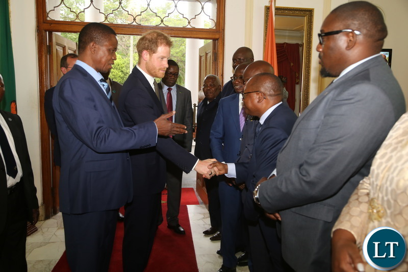 President Edgar Lungu introduces Special Assistant to the President for Economic Development Affairs Hibeene Mwiinga to Prince Harry the Duke of Sussex at State House when the Prince called on the President