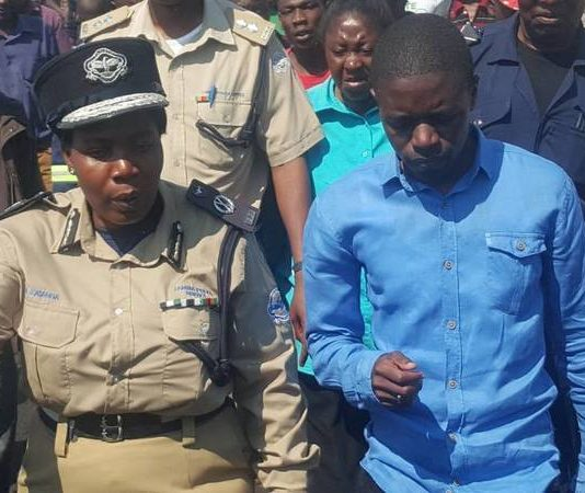 FILE: Copperbelt Police Commissioner Charity Katanga with Copperbelt Province Patriotic Front (PF), Youth Chairman Nathan Chanda