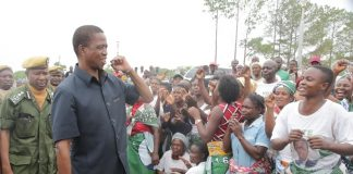 resident Edgar Lungu flashes the party symbol when he arrived at Mansa Airport enroute to Lupososhi District for campaign rallies