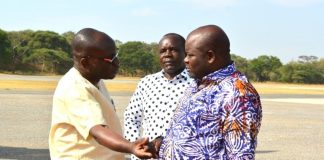 Presidential Assistant for Press and Public Relations,Amos Chanda(L) confers with Minister of Infrastructure,Ronald Chitotela(R) at City Airport.