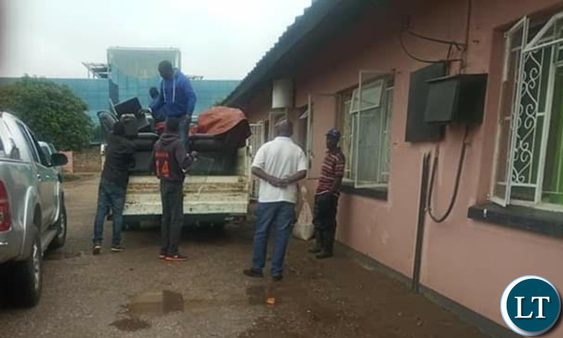 Bailiffs loading the household items seized from Mr Tayali's house