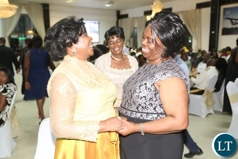 Minister of Lands Jean Kapata having a light moment with former first Lady Maureen Mwanawasa during the Zambia Air Force Annual Ball at Chamba Valley Banquet Hall