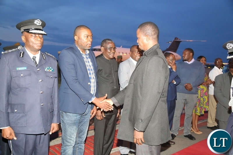 President Edgar Lungu being welcomed by Lusaka Province Minister Bowman Lusambo on his arrival at Kenneth Kaunda International Airport from Japan state visit