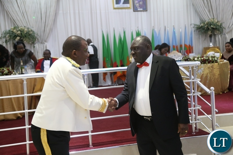 Zambia Air Force Commandant Lt. Gen David Muma shake hand with Minister of Defence Davis Chama during the Zambia Air Force Annual Ball at Chamba Valley Banquet Ha