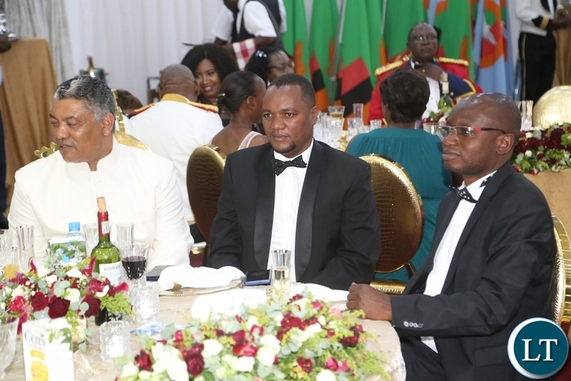 Minister of Justice Given Lubinda (l) Special Assistant to the President for Press and Public Relations Amos Chanda (r) and Lusaka Mayor Miles Sampa follow the proceeding during the Zambia Air Force Annual Ball at Chamba Valley Banquet Hall