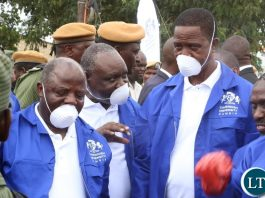Cavendish University Vice Chancellor Dr. Kalombo Mwansa flanked by Cavendish University Council Chairperson Dr. Overs Banda confers with President Edgar Lungu during the Cavendish University Keep Zambia Clean, Health and Green at Kafue Roundabout
