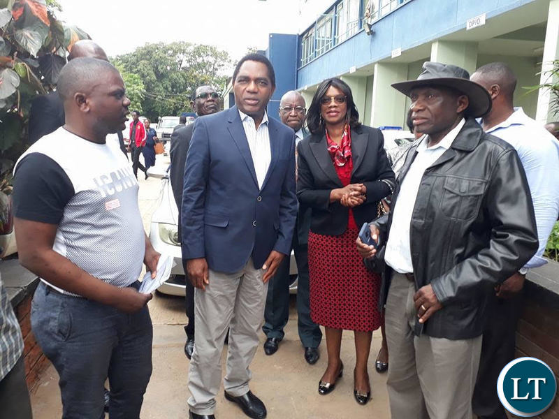 Mr Hichilema with other opposition figures at Lusaka Central Police.