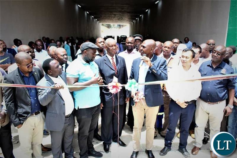 Copperbelt province Minister Japhen Mwakambe officially re-opening part of the road on Dag Hammersjoid commonly known as the under bridge