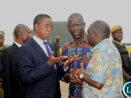 President Edgar Lungu confers with Patriotic Front Secretary General Davies Mwila and Defence Minister Davies Chama before departure for Japan at Kenneth Kaunda International Airport