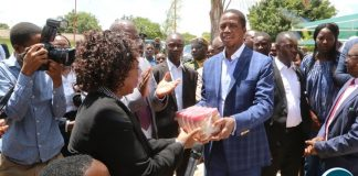 President Edgar Lungu present the assorted food staffs to Chainama Mental Hospital Senior Medical Superintendent Dr. Margaret Chibowa shortly after touring the facility