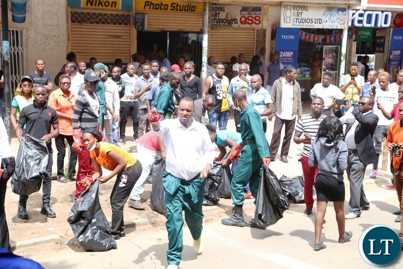 Lusaka Mayor Miles Sampa with Lusaka City Council Police and others Staffs Cleaning the Central Business District