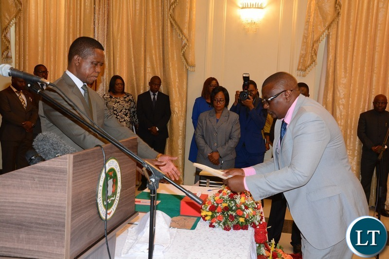 President Edgar Lungu receives latter of Oath from the Newly Appointed Permanent Secretary Central Province Bernard Chomba during swearing in ceremony at State House