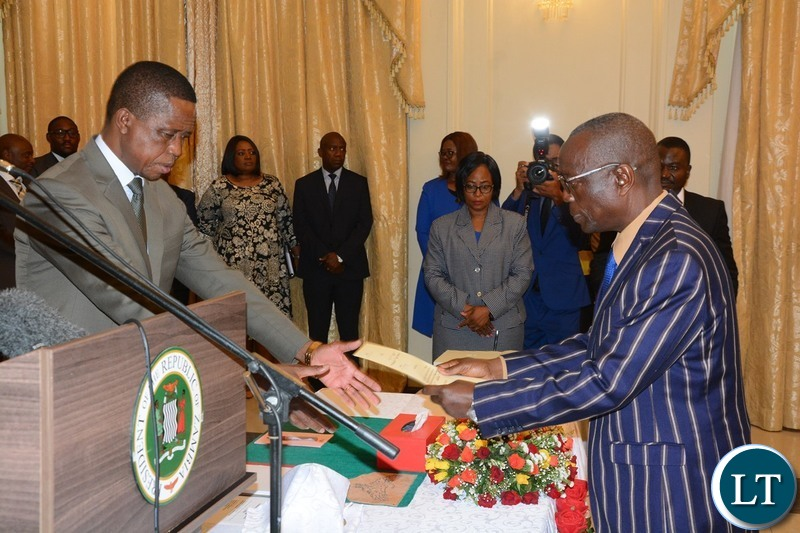 President Edgar Lungu receives the letter Oath from the Newly Appointed Permanent Secretary North Western Willies Mangimela during swearing in ceremony at State House