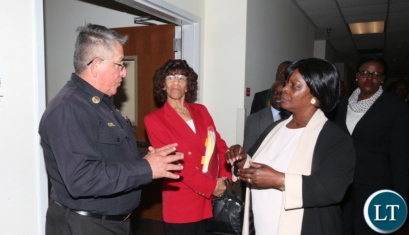 First Lady Esther Lungu listens to Los Angeles Fire Department Battalion Chief Ray Gomez (L) during a tour of Los Angeles Fire Department- Fire Station 4 in California, United States of America on Tuesday, January 22,2019-Pictures by THOMAS NSAMA