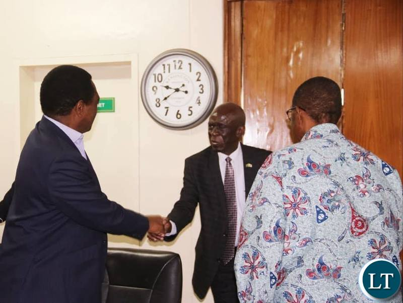 UPND leader Hakainde Hichilema meeting with ECZ Deputy commission chairperson,Commissioner Ali Simwinga, while GBM looks on