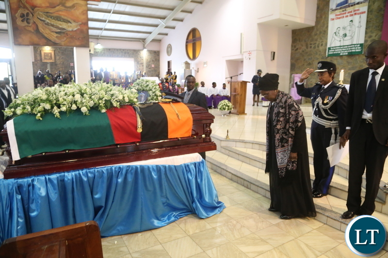 Acting President Inonge Wina paying her last respect to the late Maj. Gen. Kapotwe Chintu at the Cathedral Child Jesus during the funeral church service