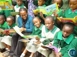 Kawangware Primary School with books donated from the Start A Library Project-FILE