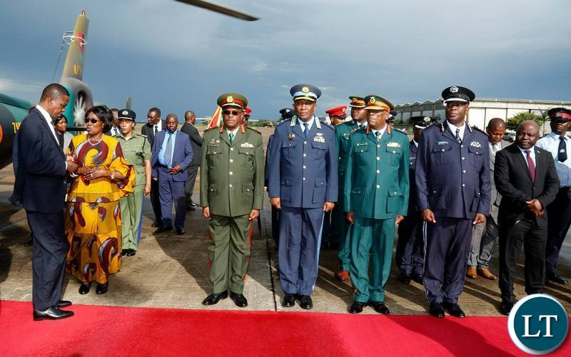 President Edgar Chagwa Lungu (left) talks to Vice-President before departure for South Africa at Zambia Air Force Base in Lusaka on Tuesday,January 8,2019. PICTURE BY SALIM HENRY/STATE HOUSE ©2019
