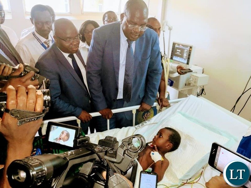 Minister of Health Dr. Chitalu Chilufya visiting the recovering Richard Zulu