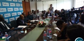 National Water and Sanitation Council Acting Director Eng. Peter Mutale (C) addressing a media briefing